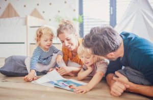 Parents reading to children at Kohlnhofer Insurance Agency